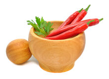 Wooden Mortar and chilli Stock Images