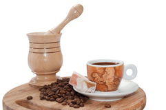 Wooden mortar with coffee of coffee and turkish delight Royalty Free Stock Images