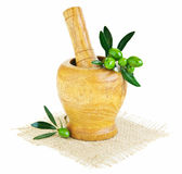 Wooden mortar with fresh green olives Royalty Free Stock Image