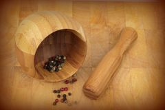 Wooden mortar and pestle with pepper mix Stock Image