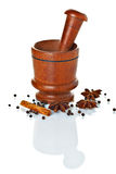 Wooden mortar and pestle with spices ready for grinding Royalty Free Stock Photo