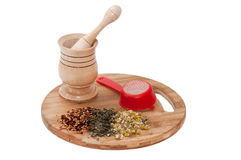 Wooden mortar and raw herbs Royalty Free Stock Photo