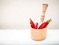 Wooden mortar and red pepper 2. Wooden mortar and red pepper over white background Stock Photography