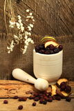 Wooden mortar and rose hips. Wooden mortar with dog rose and dried apples Stock Images