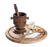 Wooden mortar with spices Royalty Free Stock Photos