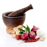 Wooden mortar with spices Stock Photos