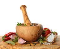 Wooden mortar and spices Royalty Free Stock Photos