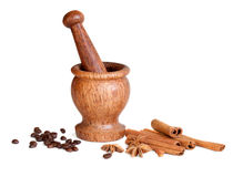 Wooden mortar, star anise, cinnamon, coffee Royalty Free Stock Photos