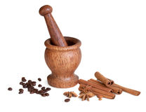 Wooden mortar, star anise, cinnamon, coffee Stock Photos
