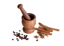 Wooden mortar, star anise, cinnamon, coffee Royalty Free Stock Photography