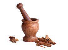 Wooden mortar, star anise, cinnamon. On a white background Stock Photo