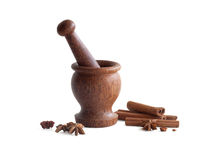 Wooden mortar, star anise, cinnamon Stock Photography