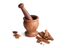 Wooden mortar, star anise, cinnamon Stock Images