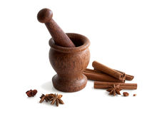 Wooden mortar, star anise, cinnamon. On a white background Royalty Free Stock Photos