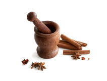 Wooden mortar, star anise, cinnamon Royalty Free Stock Image