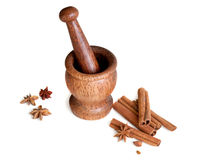 Wooden mortar, star anise, cinnamon Royalty Free Stock Photo