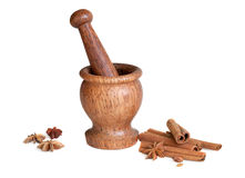 Wooden mortar, star anise, cinnamon Stock Image