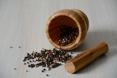 Wooden mortar on the table with dry pepper. Of various sorts Royalty Free Stock Photography
