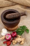 Wooden mortar with various spices Stock Photo