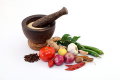 Wooden mortar with various spices Royalty Free Stock Photo