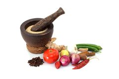 Wooden mortar with various spices Stock Photos
