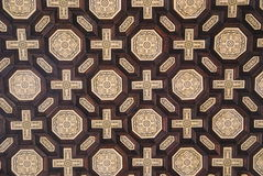 Wooden mosaic. Detail of a wooden mosaic ceiling with complex patterns Stock Image