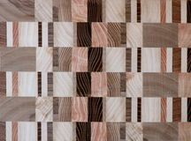 Wooden mosaic patterns. Assembly of various pieces of wood Royalty Free Stock Photography