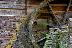 Wooden moss covered water wheel on an old grist mill Royalty Free Stock Photos