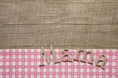 Wooden mothers day background with text mum in german language. Royalty Free Stock Images