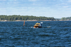 Wooden motorboat in Finnish archipelago Stock Photography