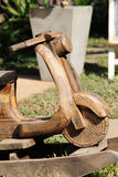 Wooden motorcycle. In the garden royalty free stock photography