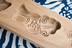 A wooden mould. With fish-shape Royalty Free Stock Photography