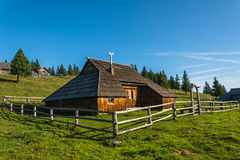 Wooden mountain cabin Stock Images