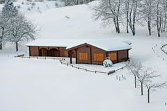 Wooden mountain chalet in the Alps in Italy Royalty Free Stock Photos