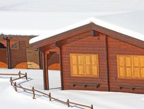 Wooden mountain chalet in the Alps in Italy after a snowfall Royalty Free Stock Photography