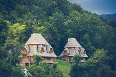 Wooden mountain cottages Stock Photography