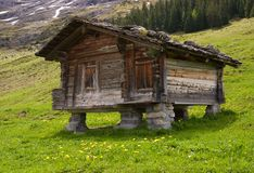 Wooden mountain hut. With a stone roof on stone piles near Grindelwald, Switzerland Stock Images