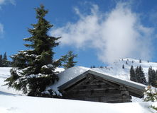 Wooden mountain hut covered by snow - austrian alps landscape Royalty Free Stock Image