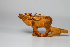 Wooden mouthpiece. He mouthpiece is handmade in the form of a deer, carved from wood Stock Image