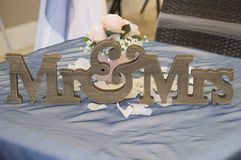 The wooden Mr&Mrs symbol on a wedding table stock photos