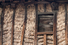 Wooden and mud wall and window. A traditional way of building wall of houses in the north of Spain with wood and mud Stock Photo