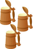 Wooden mug of beer Royalty Free Stock Images