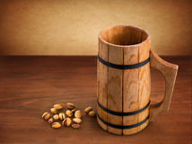 Wooden mug with beer Stock Image