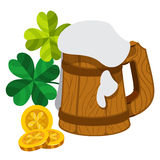 Wooden mug of beer foam, three gold coins with four-leaf clover. Royalty Free Stock Photo