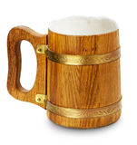 Wooden mug with beer isolated on the white background Royalty Free Stock Photo