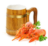 Wooden mug with beer and red lobsters isolated on a white backgr Stock Photo