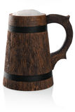 Wooden mug of fresh beer with foam cap. Royalty Free Stock Photography