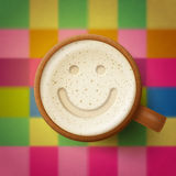 Wooden mug with frothy drink and smiling face Royalty Free Stock Photos