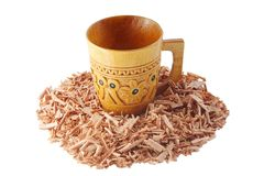 Wooden  mug and juniper shavings isolated on white Stock Image
