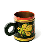 Wooden mug, painted in the style of Khokhloma. Wooden mug, painted with floral ornament in the style of Khokhloma Royalty Free Stock Photos